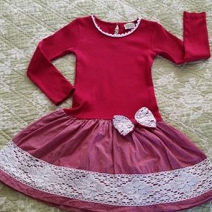 Red dress with long sleeves , lace details